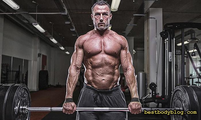 Шраги со штангой стоя | Основное упражнение для набора мышечной массы трапеций