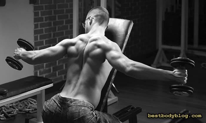 Розведення з гантелями на плечи
